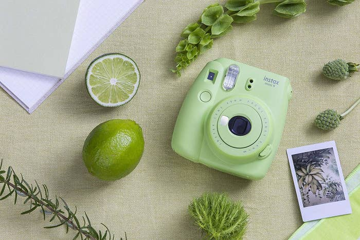 The light green camera and the rectangular photo it prints out