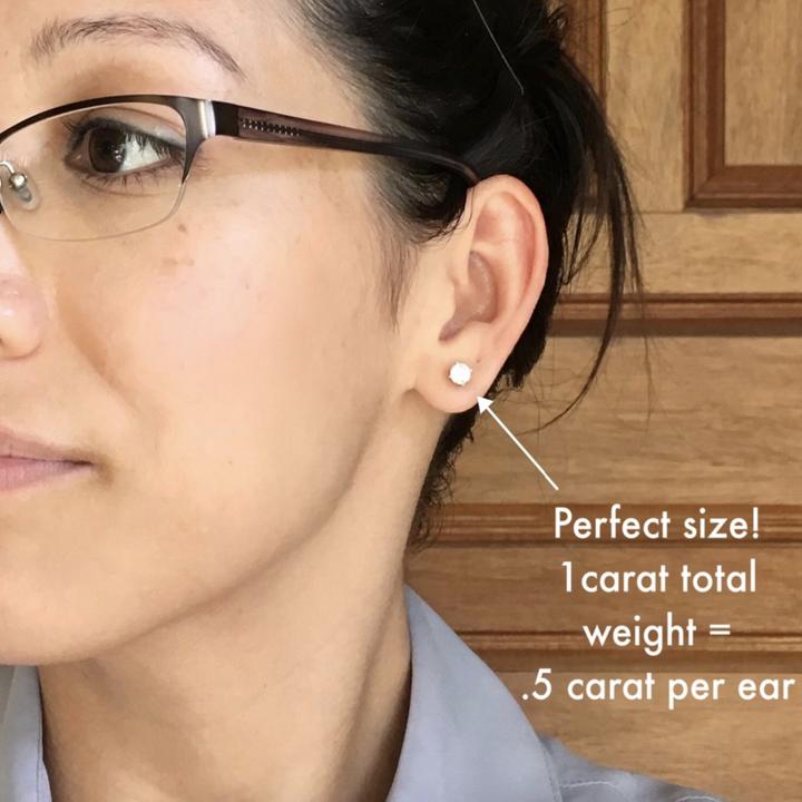 reviewer wearing earrings