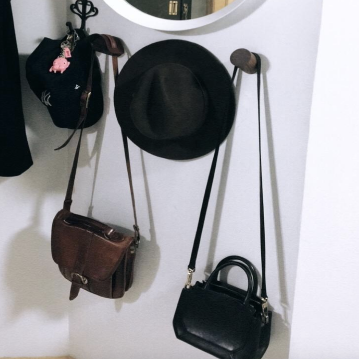 a reviewer's hand bags hung up on the hooks