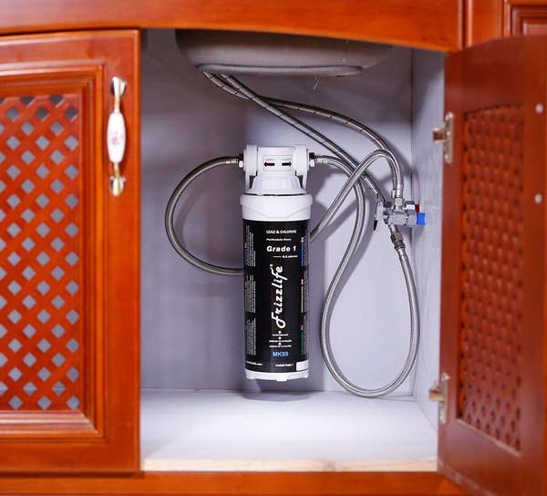 The system hooked up in the cabinet under a kitchen sink (it's about the size of a small fire extinguisher)