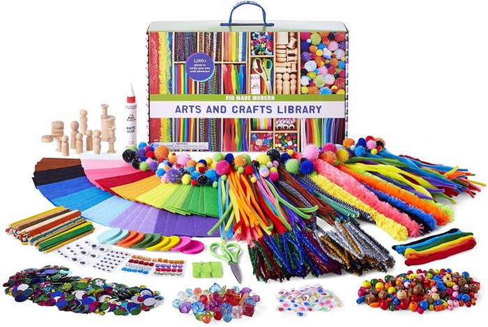 the contents of the arts and crafts library laid out in fronts of its box