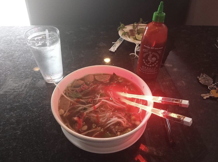 lightsaber chopstick with red light in a bowl of food