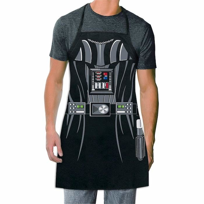 model wearing the apron that looks like the Darth Vadar's costume