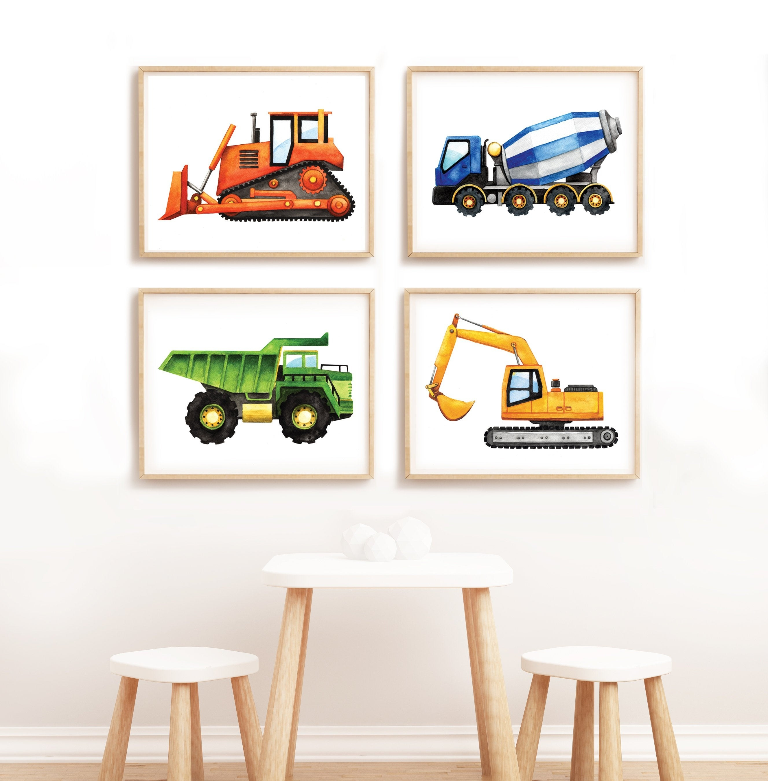four framed construction vehicle prints