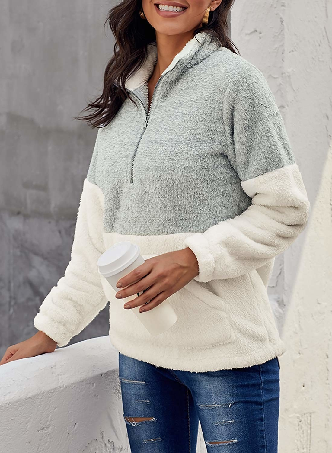 A model wearing the fleece pullover.