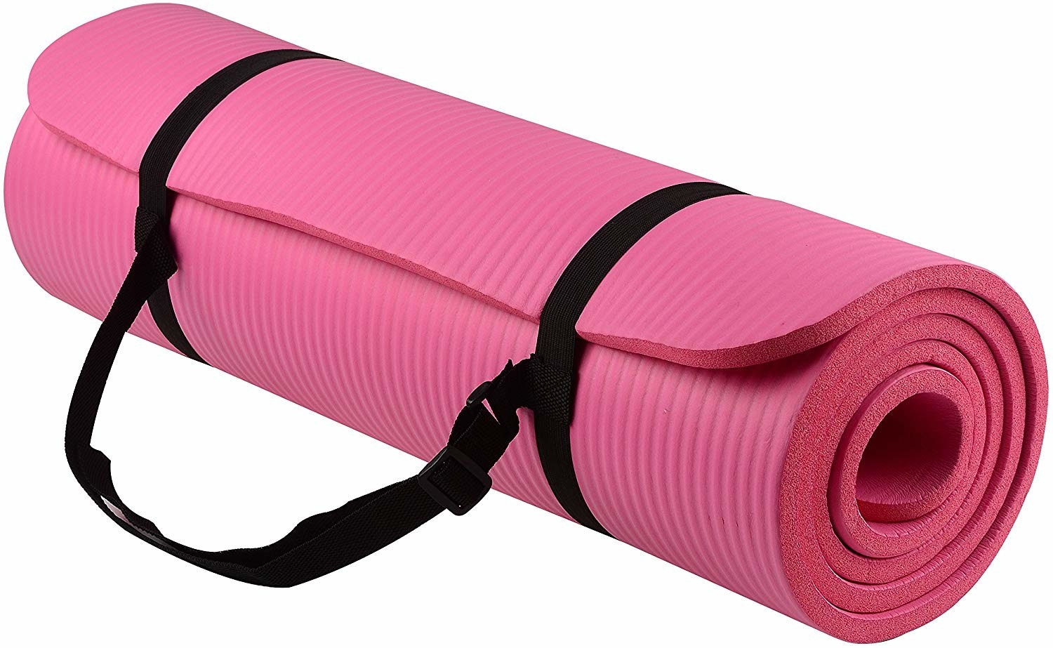 The yoga mat rolled up and held in place by a strap