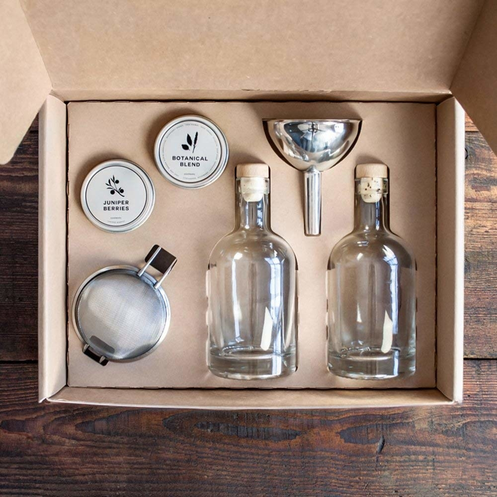 The kit with two glass bottles, a funnel, blends, and a sifter