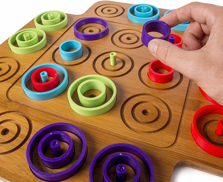 concentric circle pieces on otrio's wooden board