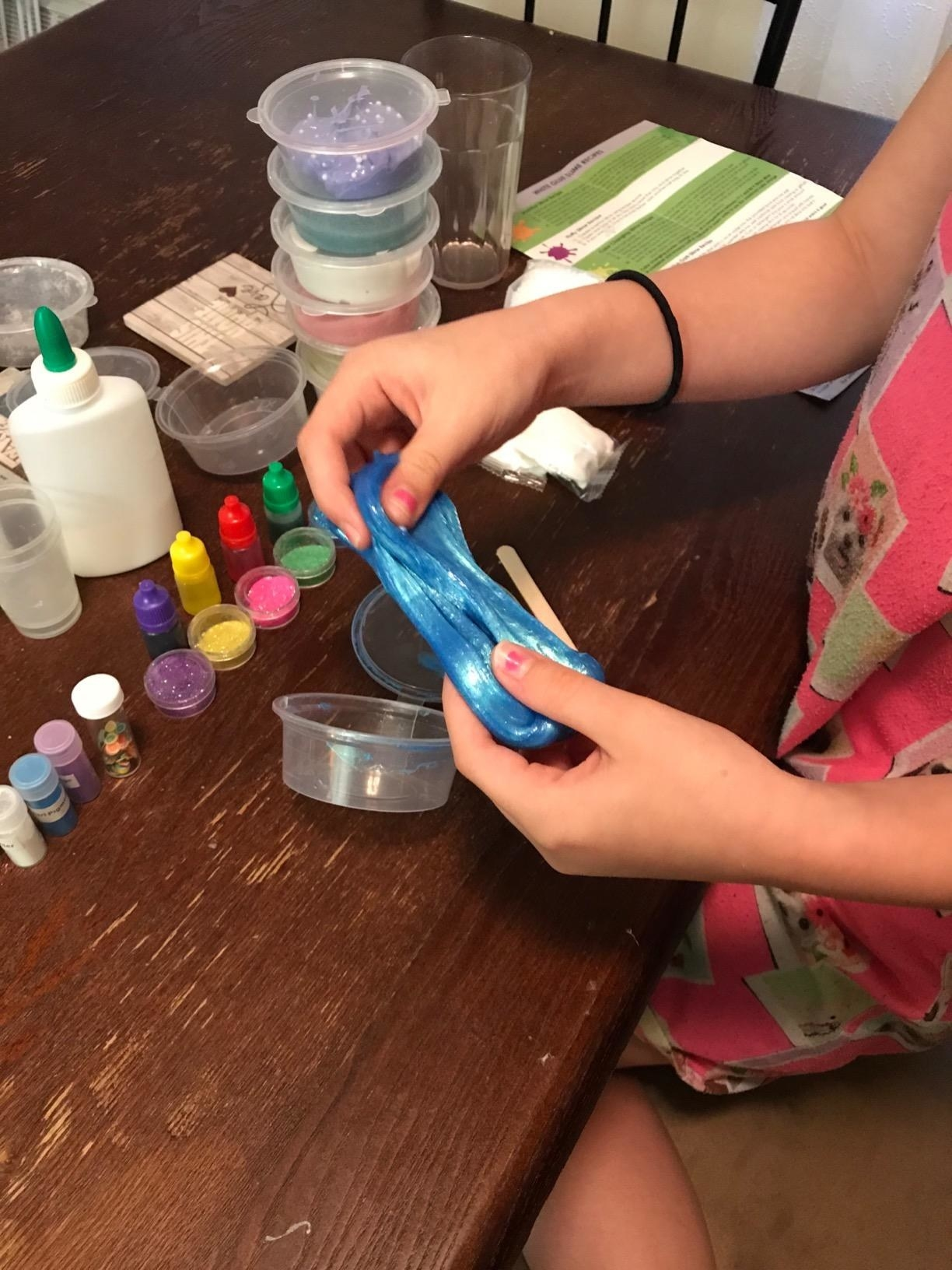 A reviewer's kid stretching blue slime