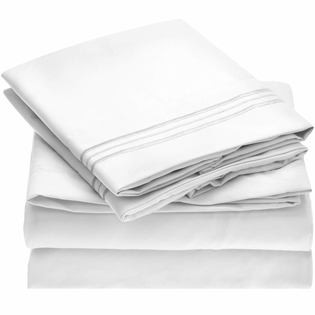 A stack of white sheets with a metallic gray stripe detail