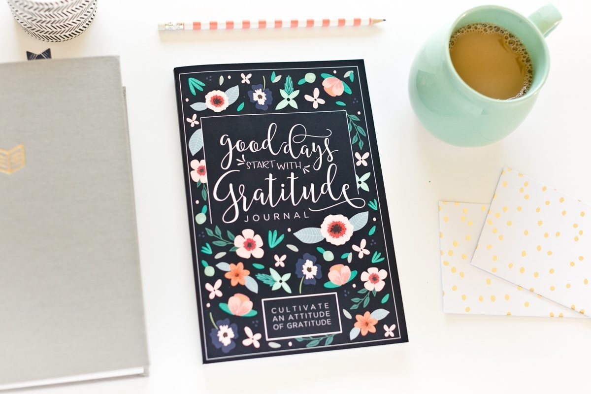 The gratitude journal on a desk.