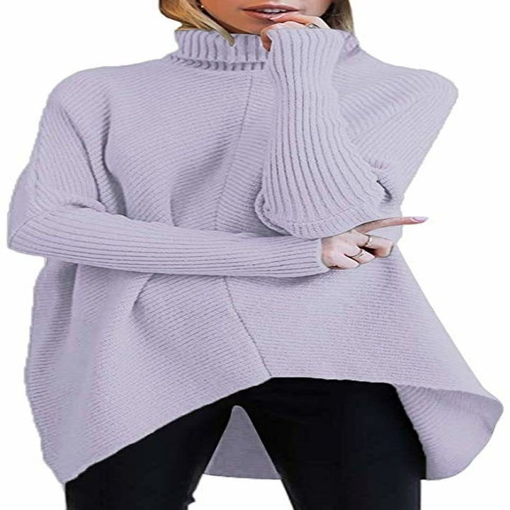 a model in the turtle neck in lavender