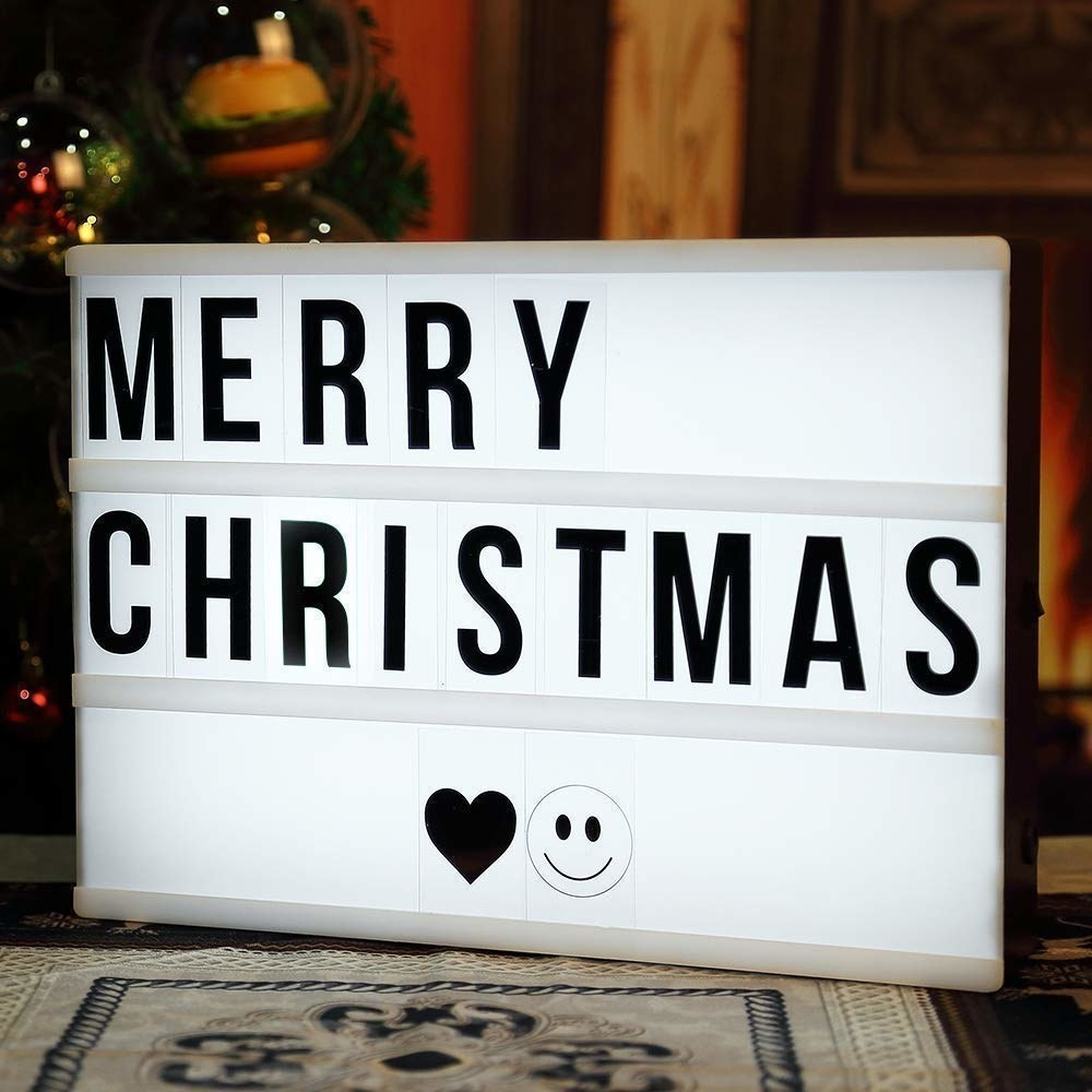 """""""Merry Christmas"""" spelled out on the lightbox."""