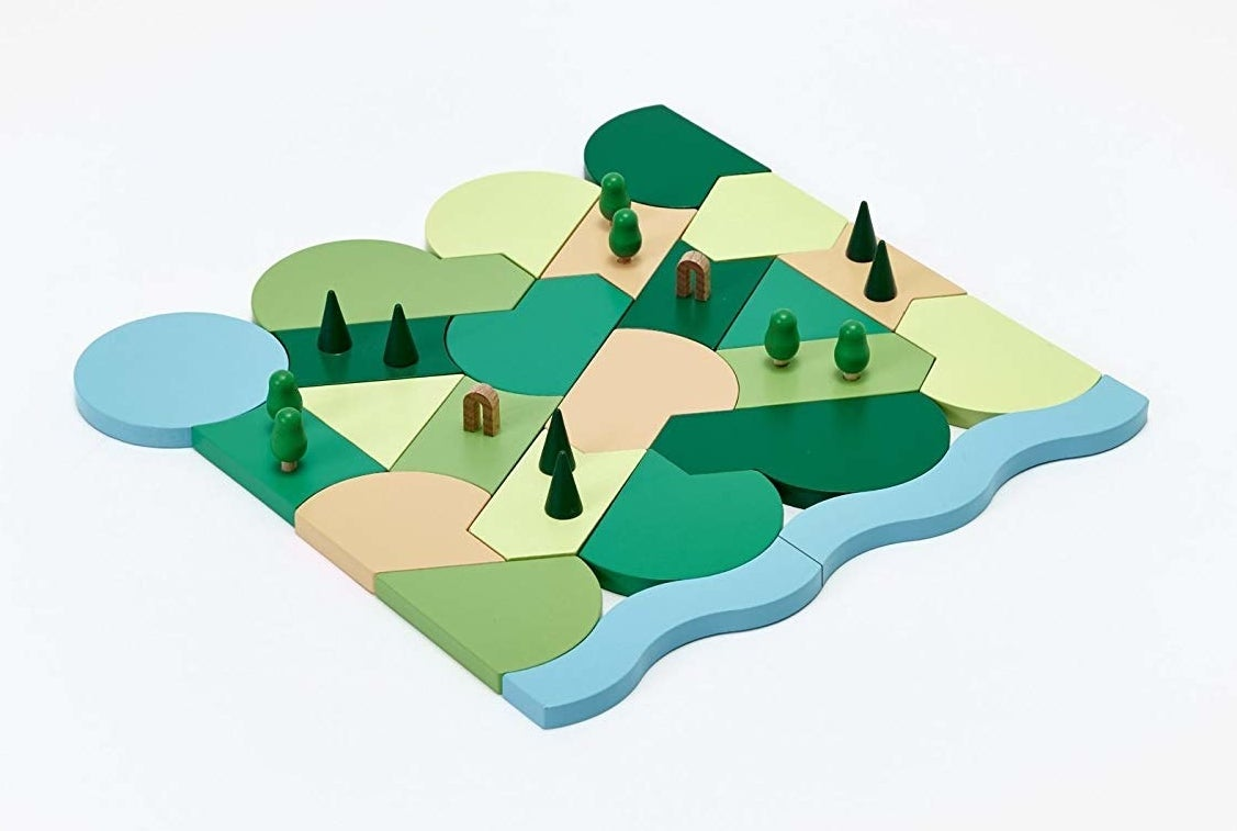 A multicolor flat-laying block set pieced together to look like a park, complete with tiny tree figures