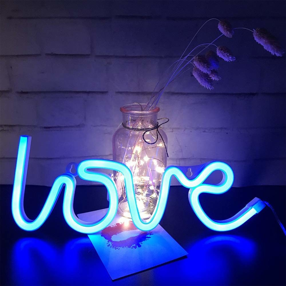 Neon light shaped to say Love