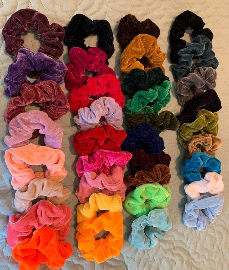 reviewer's assortment of colorful velvet scrunchies