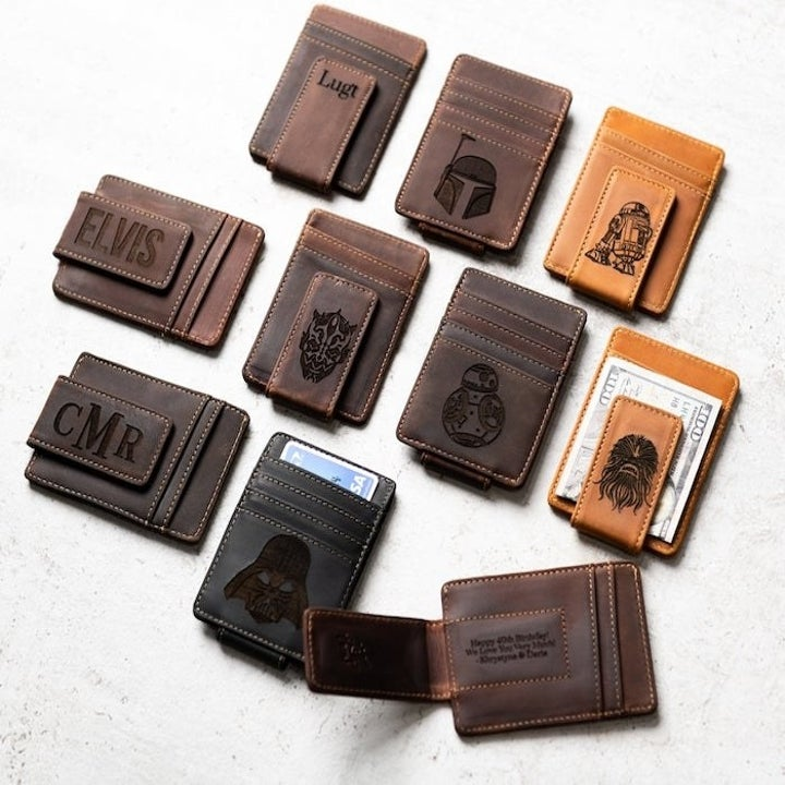Nine wallets in dark brown, brown, and light brown with a different Star Wars character on each one