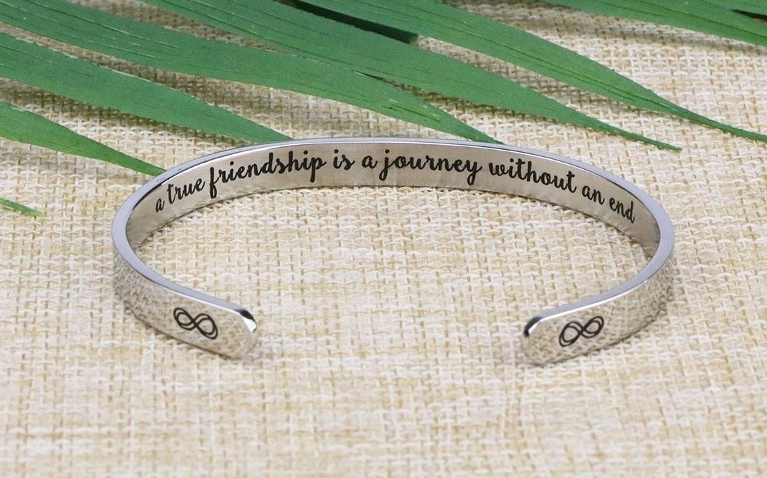 the silver cuff bracelet with the writing on the inside