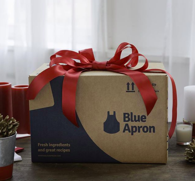 A Blue Apron box wrapped in a big red bow.