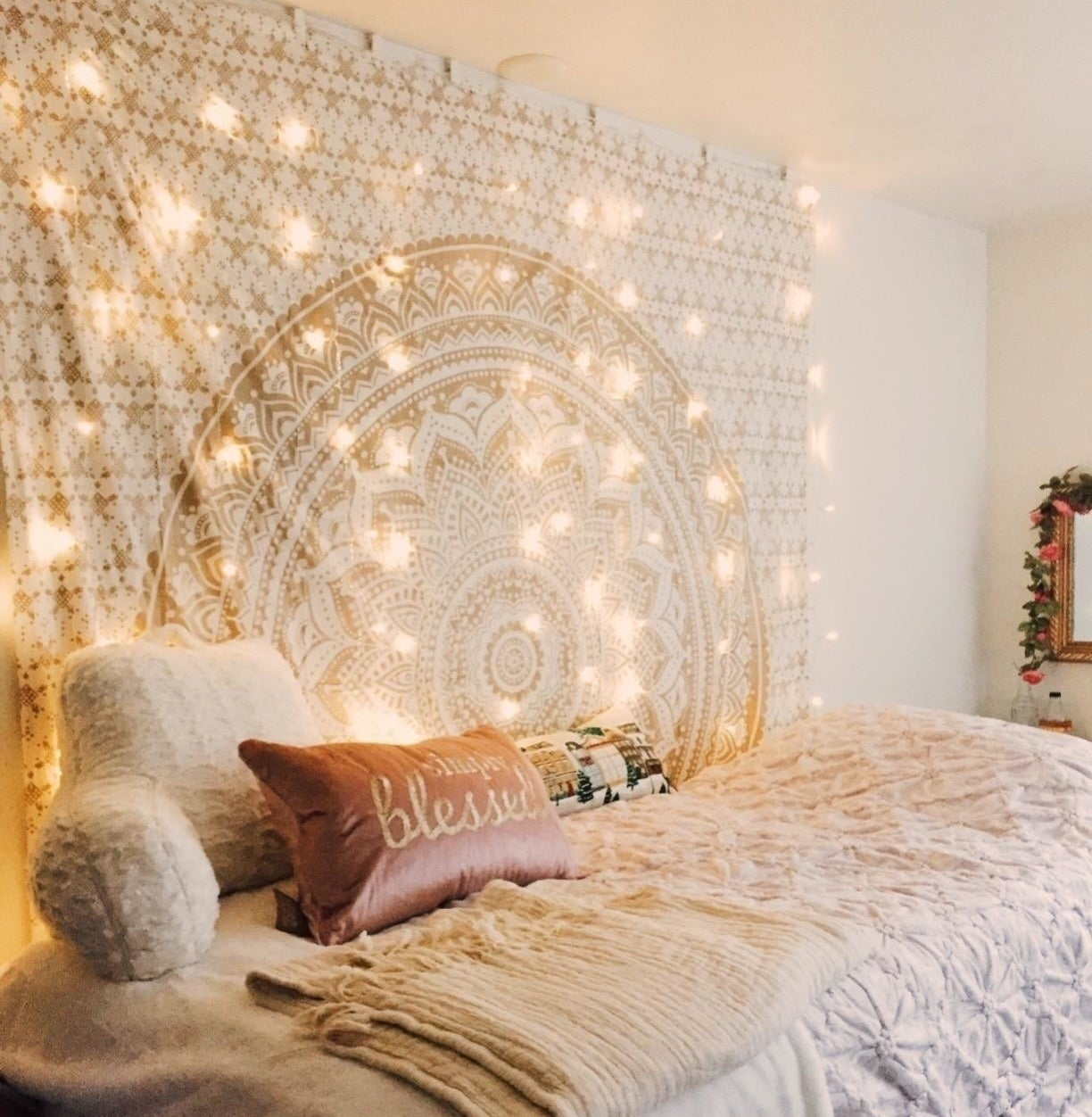 reviewer's twinkle lights above their bed