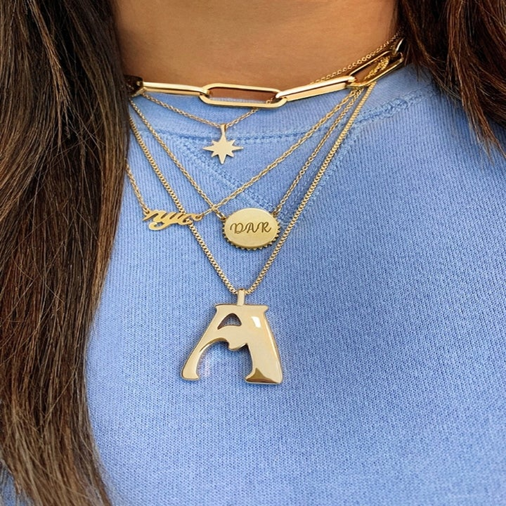 """model wearing the """"A"""" necklace"""