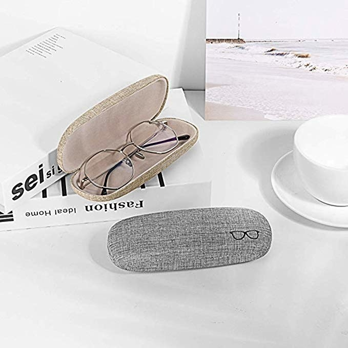 open glasses case with reading glasses inside of it