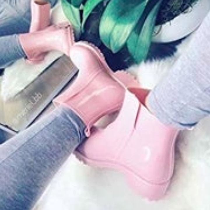 A close up of the boots in pink.