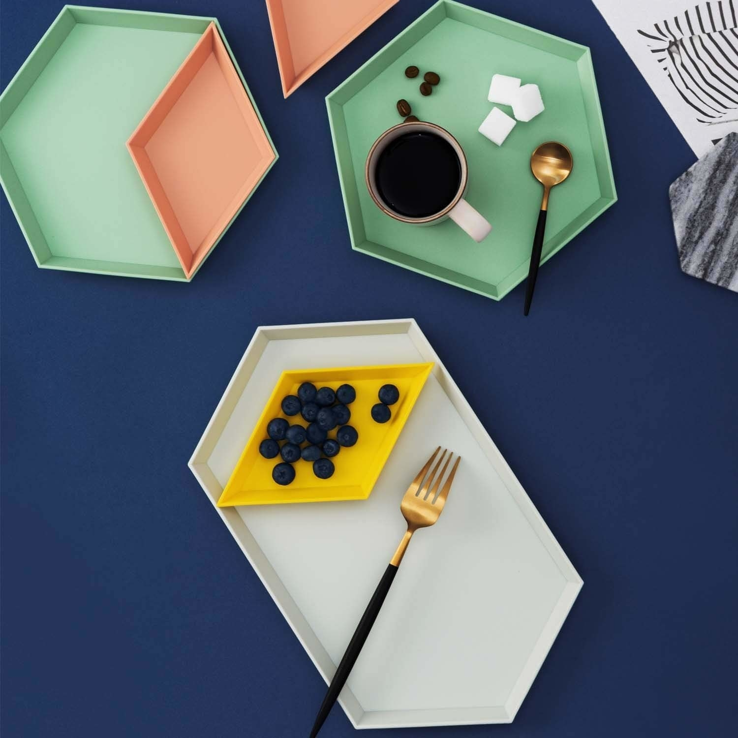 The geometric trays being used as a table setting.