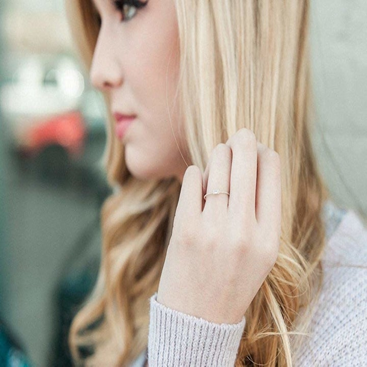 A person modeling the ring.