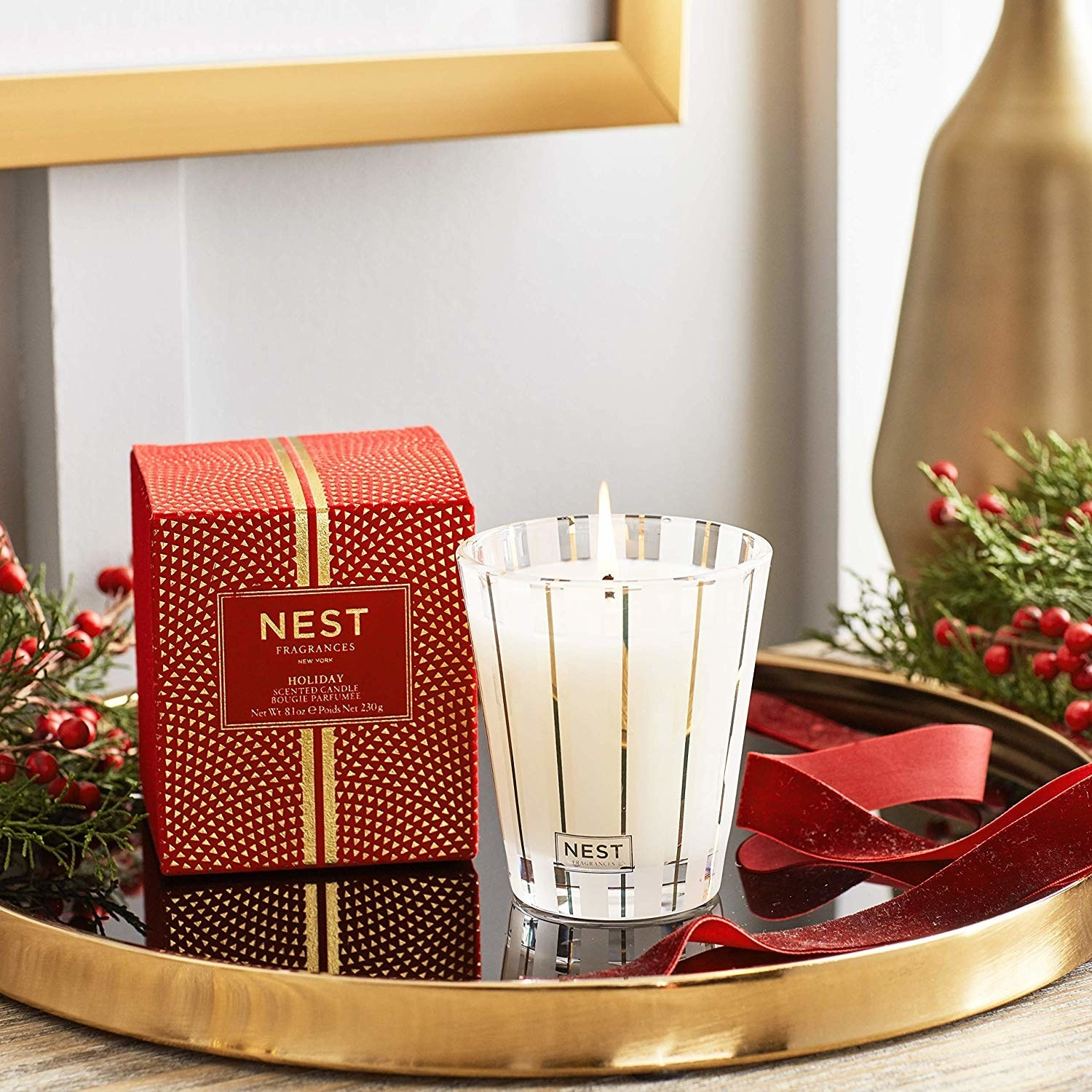 A holiday Nest Candle set up as decor.