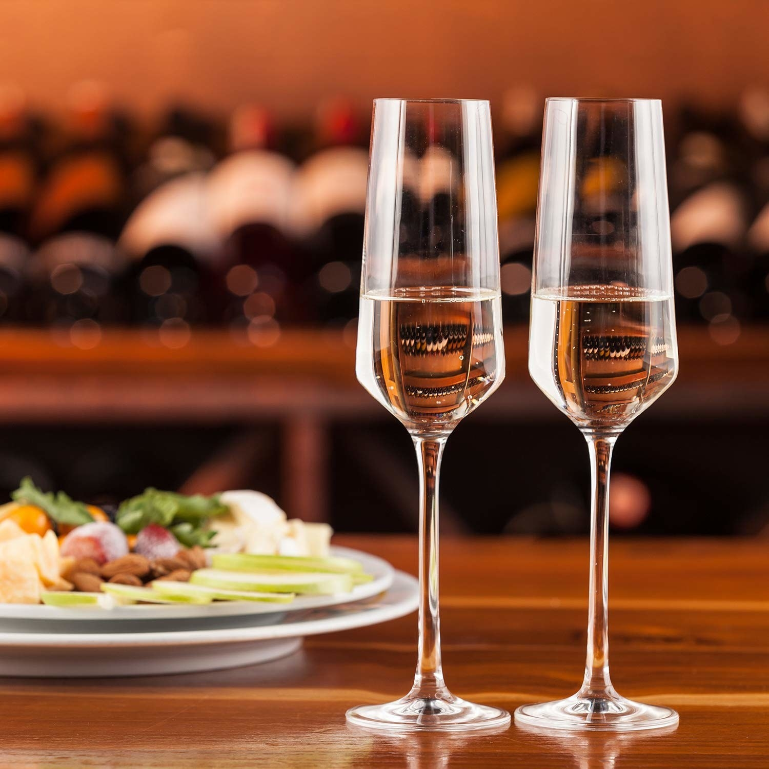 The champagne flutes filled with bubbly.