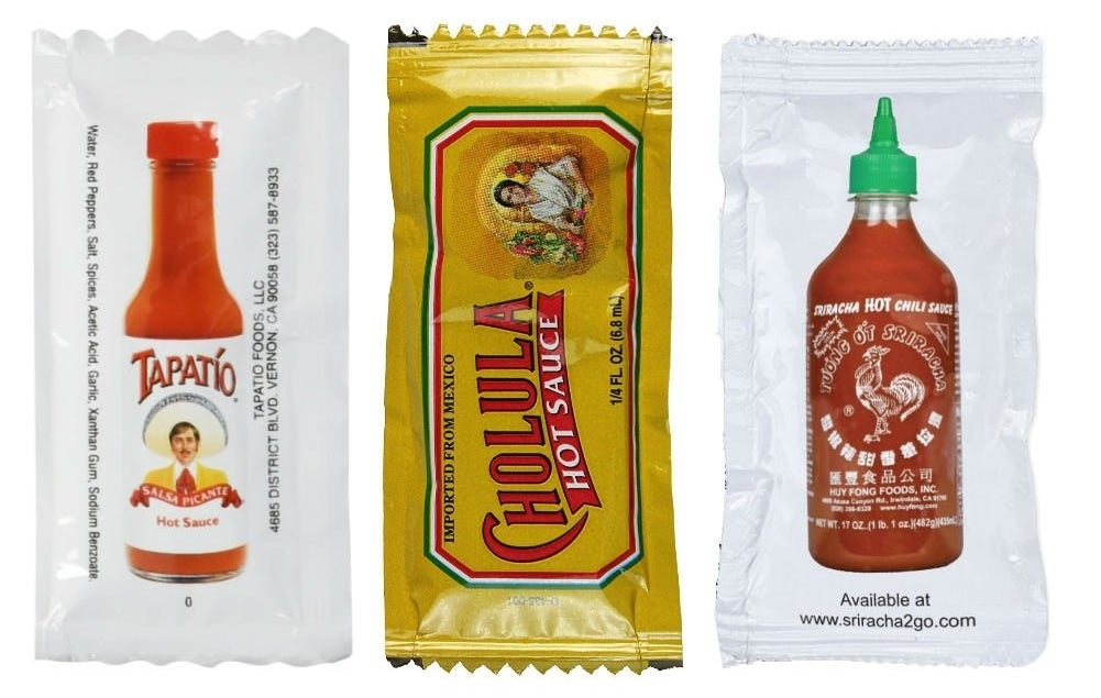 packets of Tapato, Cholula, and Sriracha sauces
