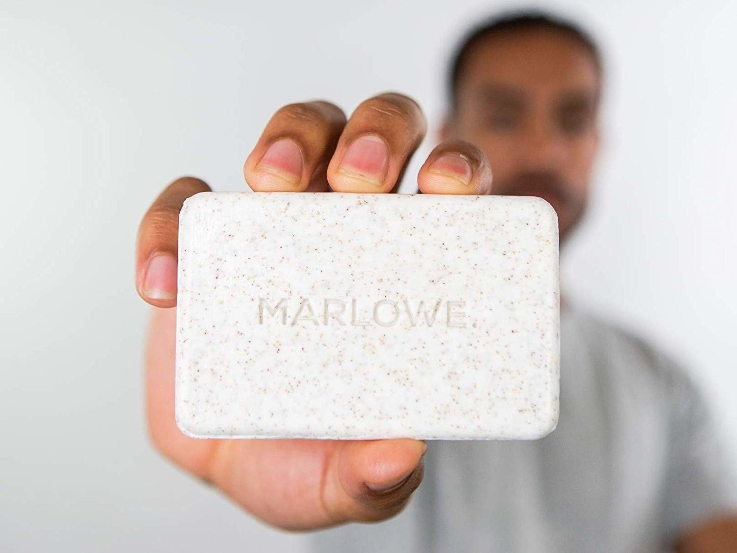 model holding the bar of soap