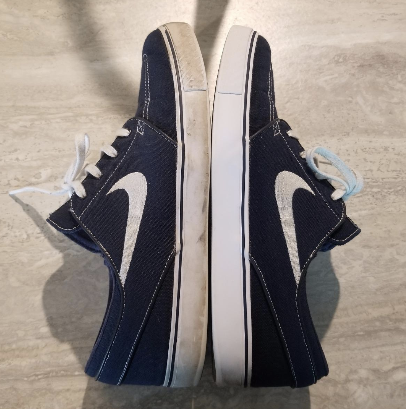 reviewer photo of Vans sneakers looking dirty on the left and clean on the right