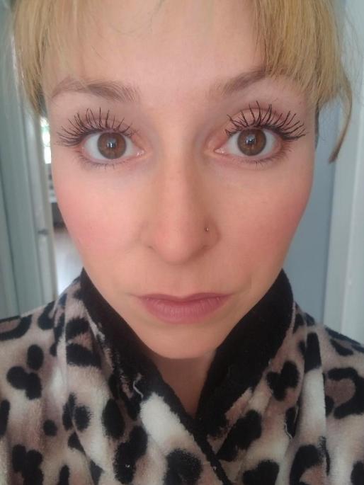 reviewer wearing the mascara with long, full eyelashes