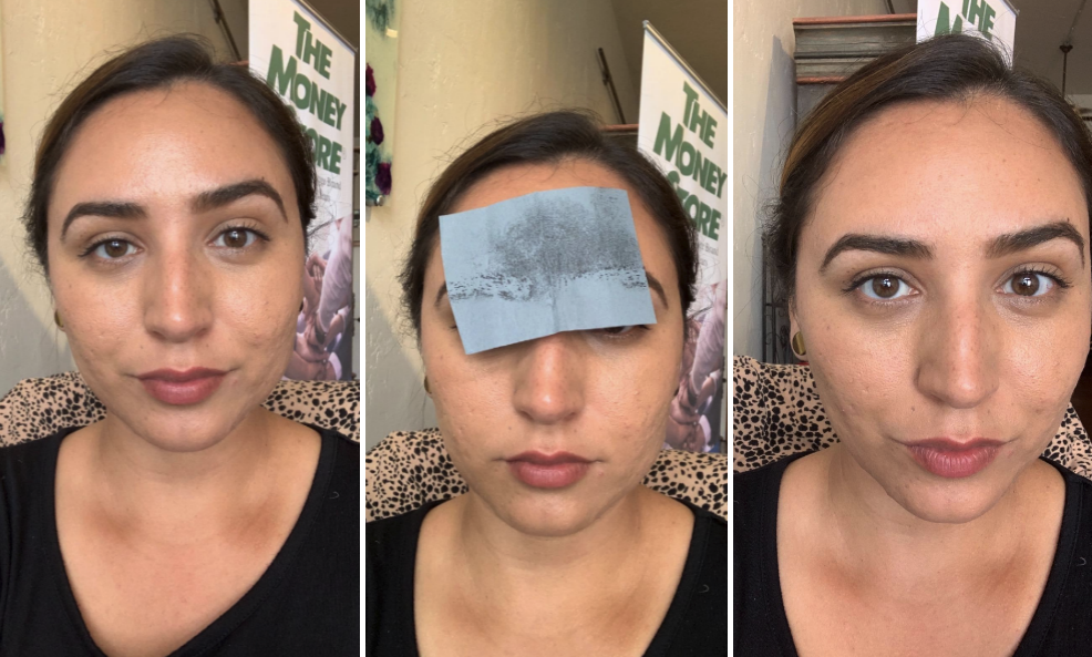 reviewer using the sheet to remove oil from forehead