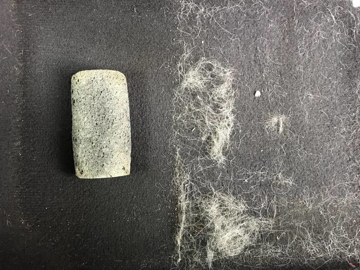 reviewer's before-and-after of the stone on a cloth seat with half of it covered in hair and the other half almost completely clear of hair