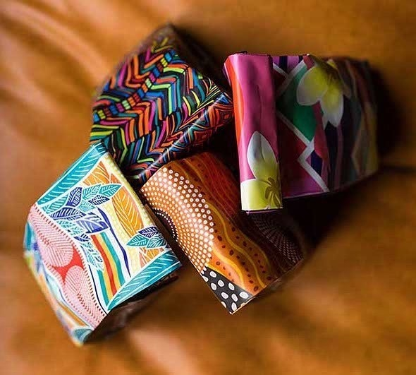 Four coffee bags with different patterns on the bag all sitting together.