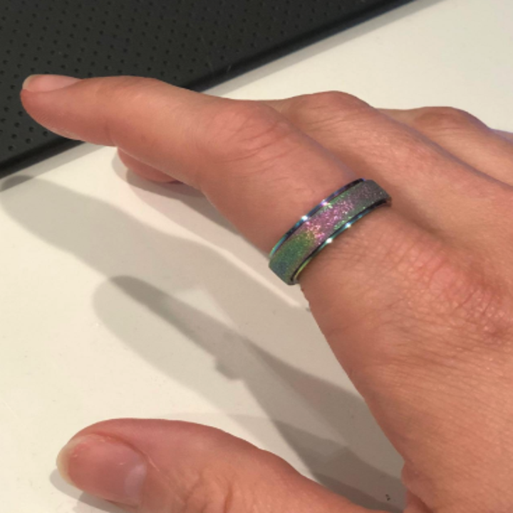 an iridescent version of the ring on a reviewer's finger