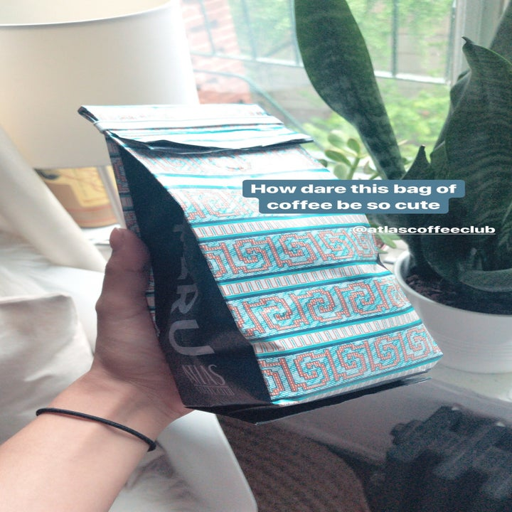 """BuzzFeed shopping editor Kayla Suazo holding the bag of coffee with the words """"How dare this bag of coffee be so cute"""" written on it."""