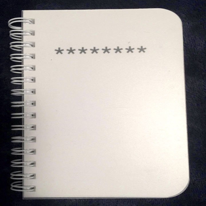 reviewer image of cover of book with a solid white cover and eight asterisks