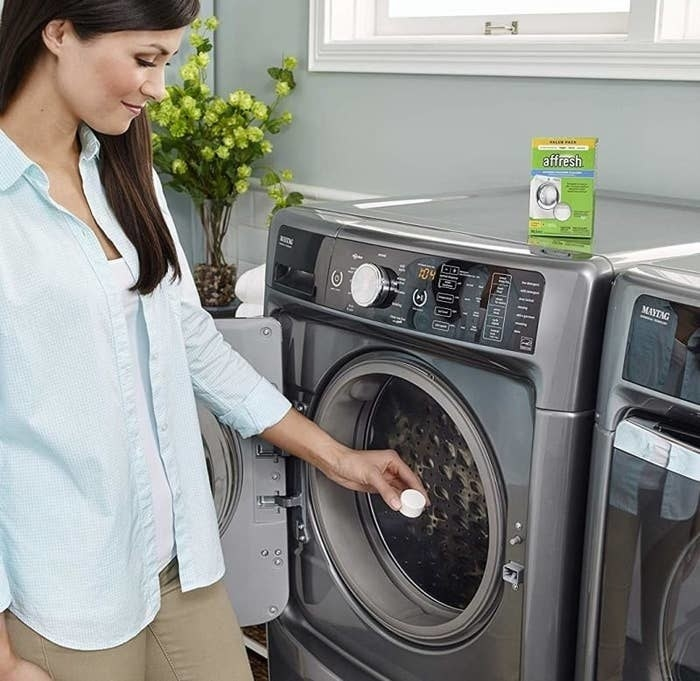 model putting a tablet in the washing machine