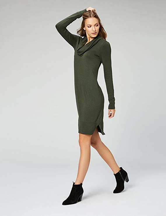 model wearing cowl neck sweater dress