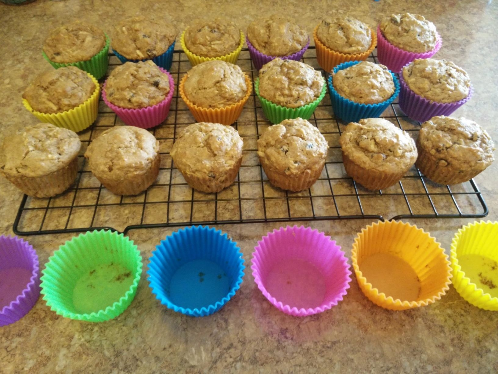 A reviewer showing muffins removed from the silicone cups