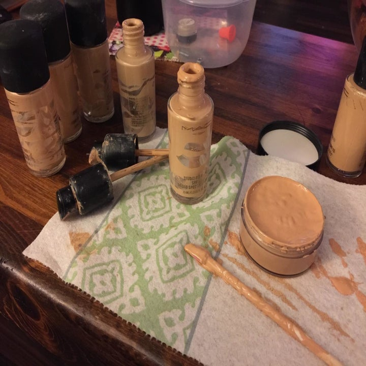 A reviewer filling a whole little jar with leftover foundation just from using the spatty