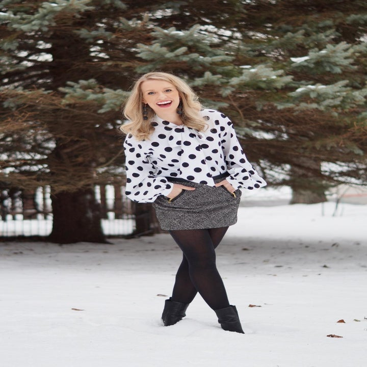 a different reviewer wearing the blouse in white with black polka dots