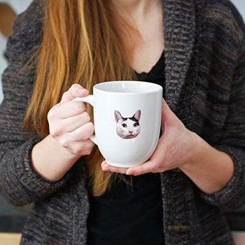 a sticker of a cat on a mug