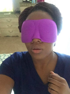 reviewer wearing the mask that covers half their face
