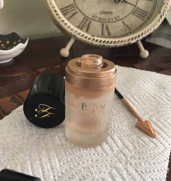 reviewer image of empty makeup bottle with contents removed with tiny spatula