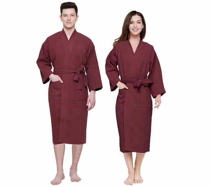 A man and a woman model the maroon bathrobe